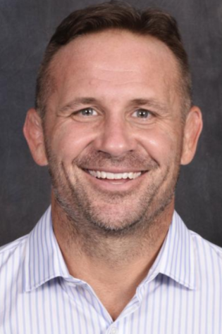 Wrestling coach receives two-game suspension