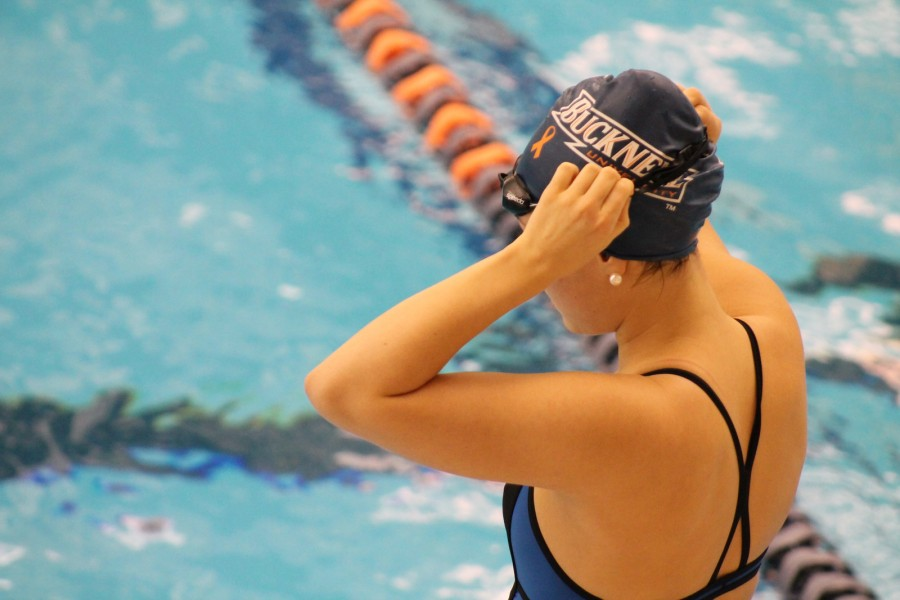Season talent shows at Bison Invite for womens swimming and diving