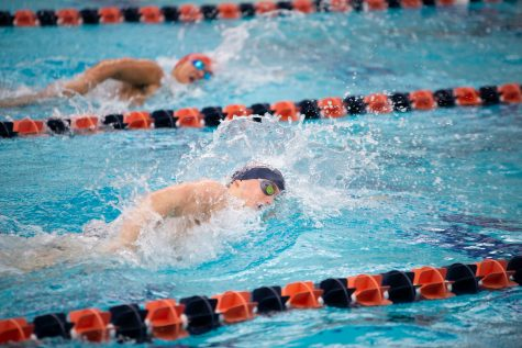 Women's swimming collects two wins, men's team loses one