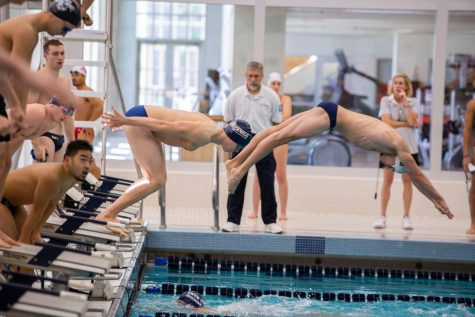 Men's and women's swimming both win two out of three at quad meet