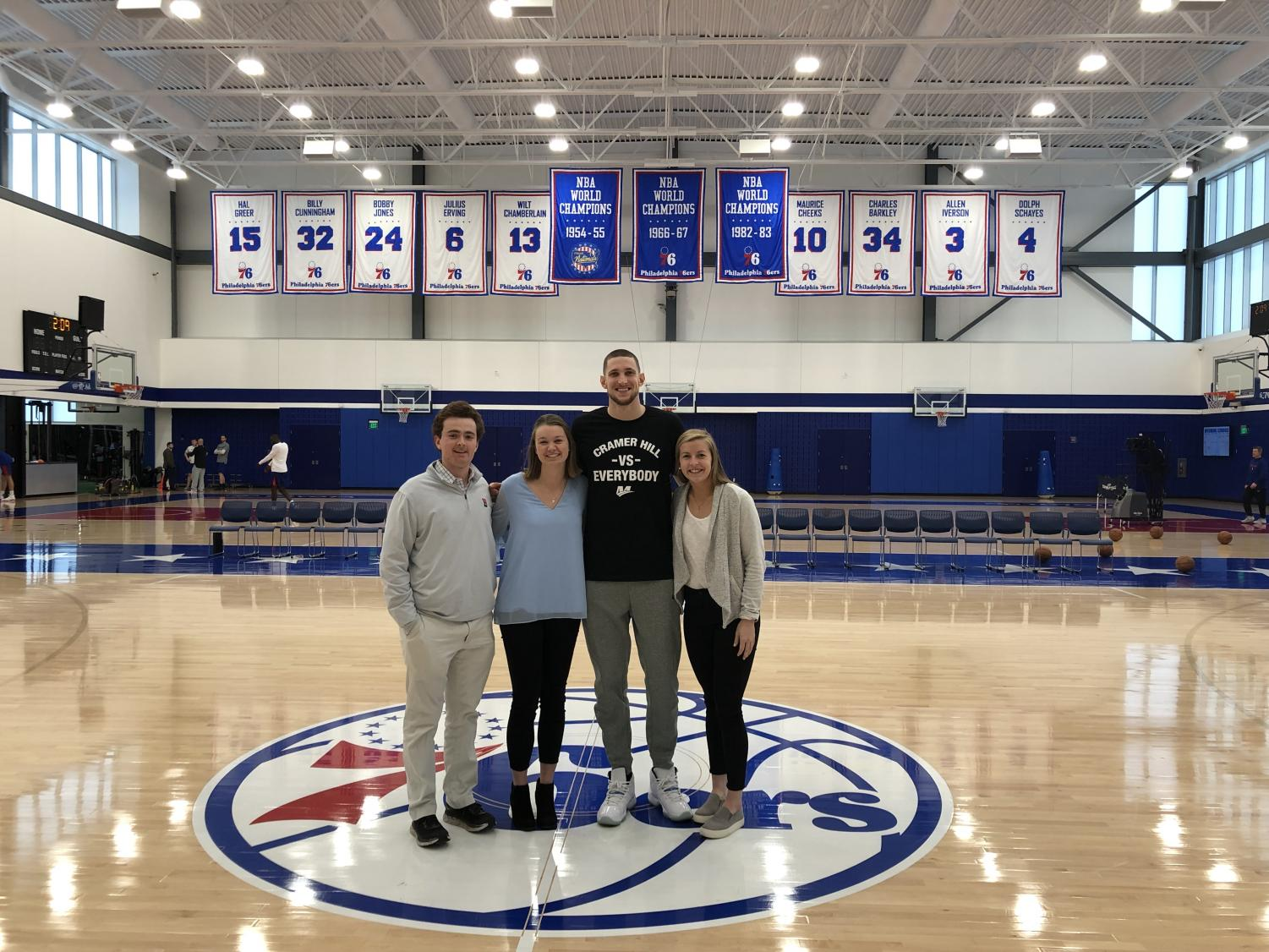 Editorial board members Patrick Dempsey, Elise Covert, and Brittany Willwerth with the 76ers' Mike Muscala '13.