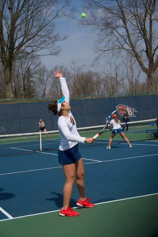 Sofia Ayuso '21serves the ball during a match against Navy on April 7.